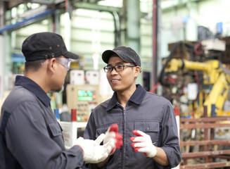 Industrial engineers in factory