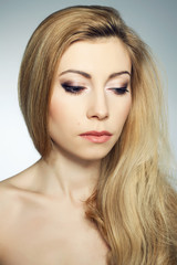 Portrait of a shy beautiful young blonde woman