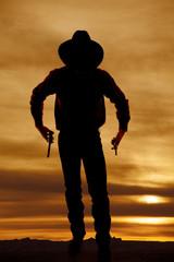 Fototapete - cowboy silhouette two guns