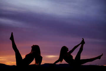 silhouette woman legs up sunset