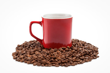 Red coffe cup into roasted coffee beans