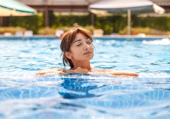 young woman relaxing in a swimming pool