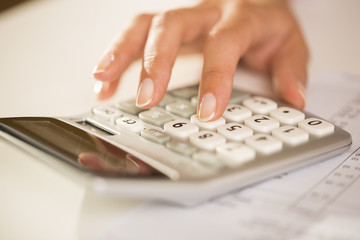 Woman's hands with a calculator, Accounting.