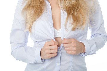 Sensuous woman unbuttoning her shirt