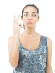 successful young woman making the victory sign