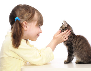 little girl and grey kitten