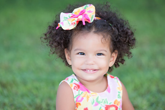 Cute and funny latin girl with an afro hairstyle