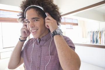 Portrait of smiling young man wearing headphones
