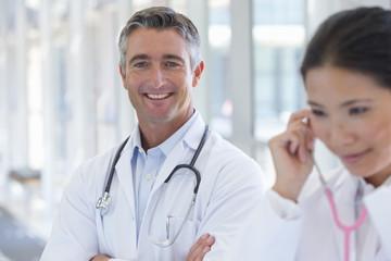 Portrait of smiling doctor in hospital