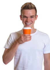 Young man drinking hot coffee