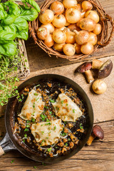 Homemade dumplings with mushrooms fried with onion and parsley
