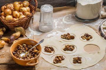 Preparing homemade dumplings with wild mushrooms