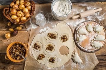 Homemade dumplings with onion and wild mushrooms
