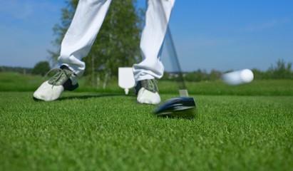 Golf, driver hitting a golf ball
