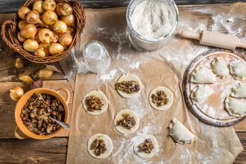 Table full of ingredients for homemade dumplings