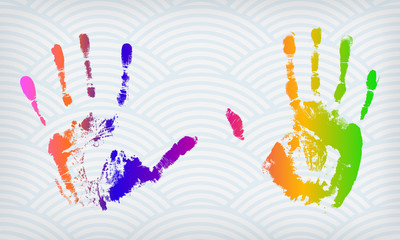 Colorful hand imprints on a waved background