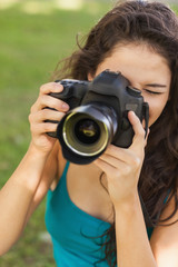 Gorgeous peaceful woman using her camera