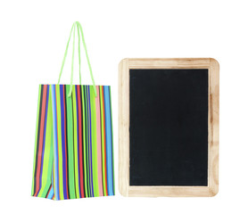 colorful shopping bag with blank chalkboard