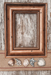 Wooden frame, burlap ribbon and seashells
