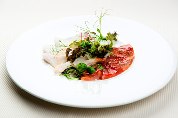 Cold appetizer, slices of trout and herring