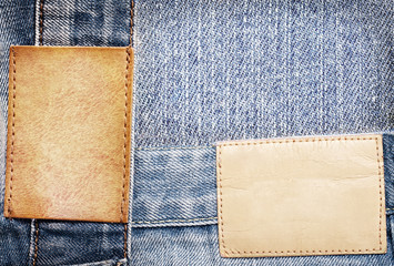 Brown leather jeans labels sewed on jeans.