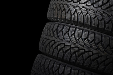 The automobile tire on black background