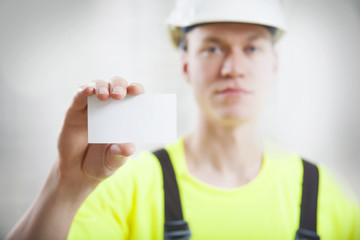 Construction worker holding business card
