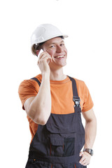 Construction worker talking to mobile phone, isolated on white