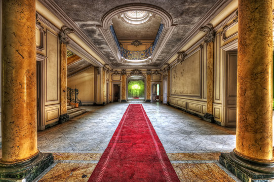 Red carpet in the hallway of an abandoned manor