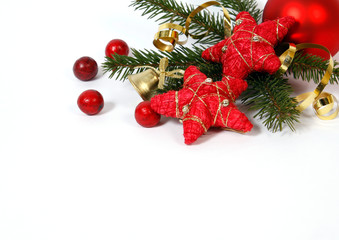 Christmas decoration with the twigs of the spruce and red stars