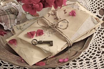 vintage background of old mail with keys on a silver plate