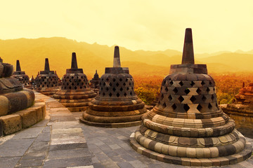 Poster Indonesia Borobudur Temple at sunset. Ancient stupas of Borobudur Temple.