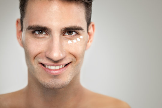 Man with anti- aging cream