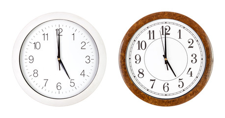 Two clock faces showing five o'clock