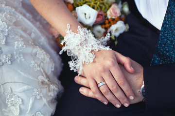 wedding ring and lace bridal gloves