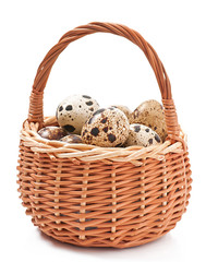 Quail eggs in a wicker basket isolated on white background