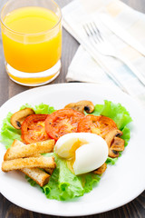 Light breakfast with soft egg, tomato and croutons