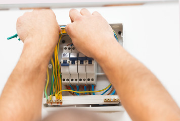 Man Mounting Electric Fuse