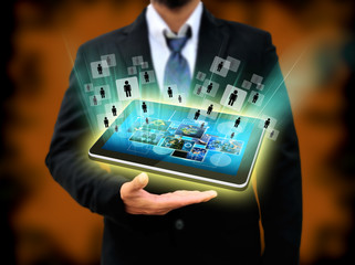 businessman holding tablet technology business concept