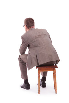 back of a young business man sitting on a chair