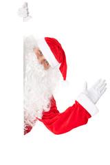 Santa Claus waving with blank sign