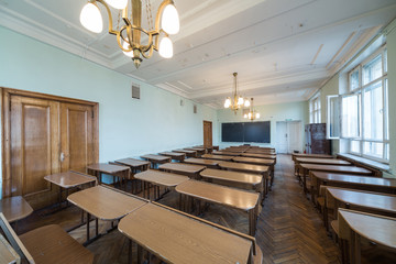 Classroom with tables and chandeliers