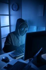 Hacker stealing data from computer