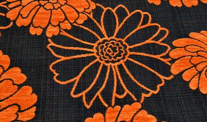 Textura de tela con flores en tonos naranjas