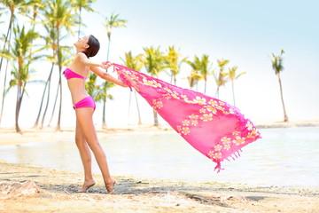 Leinwandbilder - Woman happy enjoying beach - scarf blowing in wind