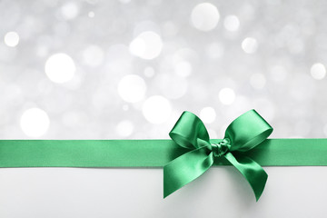 Green ribbon bow with bokeh