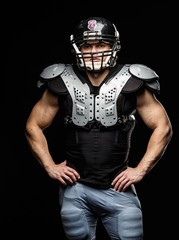 American football player wearing helmet and protective armour