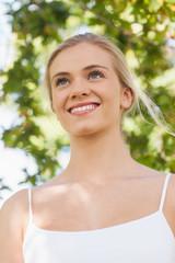 Cute blonde woman smiling while posing