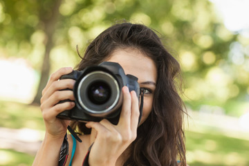 Pretty brunette woman taking a picture