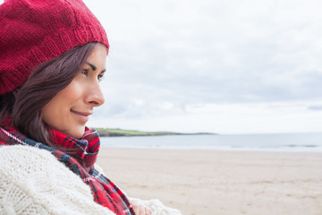 Wall Mural - Woman in knitted hat and pullover at beach